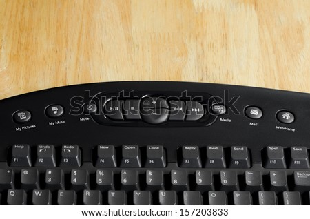 Close-up button of black keyboard on wood table