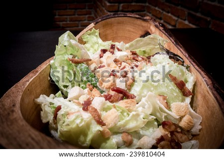 Close up Caesar Salad served in Wood Bowl - stock photo