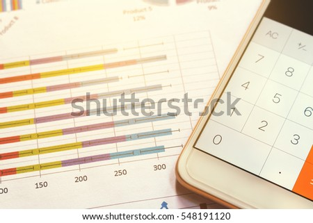 Close up calculator in smartphone and summary report on table office.
