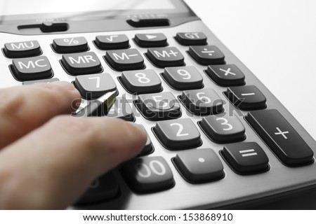 close up calculator with finger & pen on white paper - stock photo