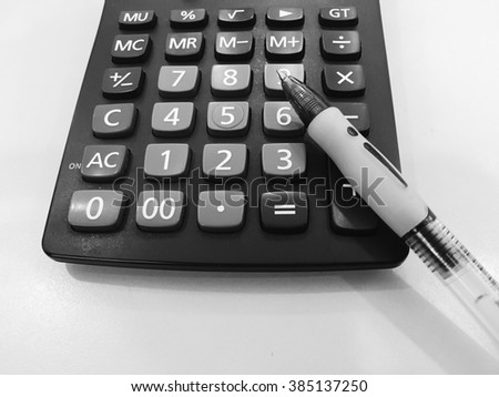 close up calculator with pen - stock photo