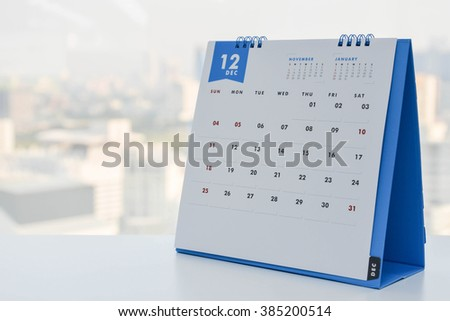 Close up - Calendar of December on the white table with city view background - stock photo