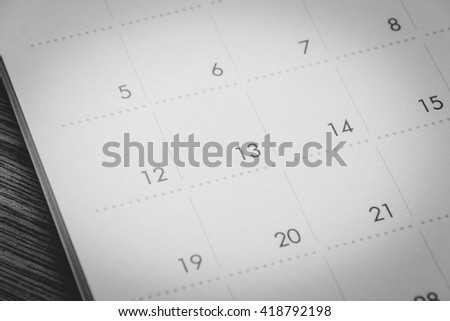 close up  calendar page on table wood background. - stock photo