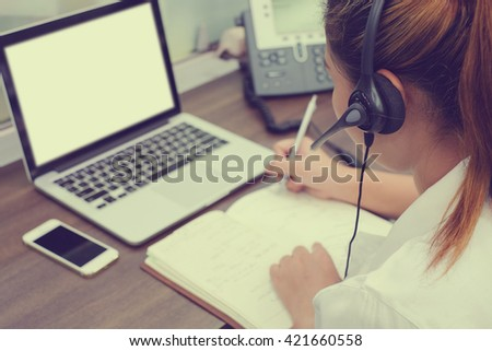 close up call centre woman work in office room:focus on headphone girl response answer customer question partner concept:people hotline job career:services support business:telecom operation employee - stock photo
