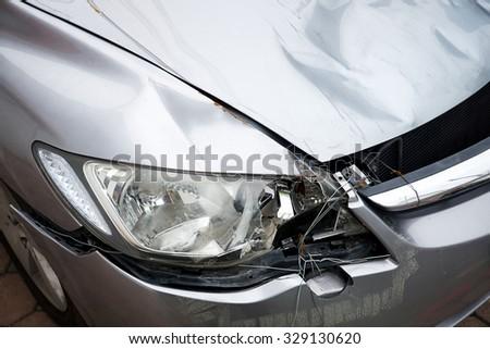 Close up Car crash damage portrayals may be broken - stock photo