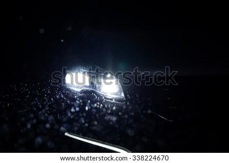Close up car lights at night. Rainy weather.  - stock photo