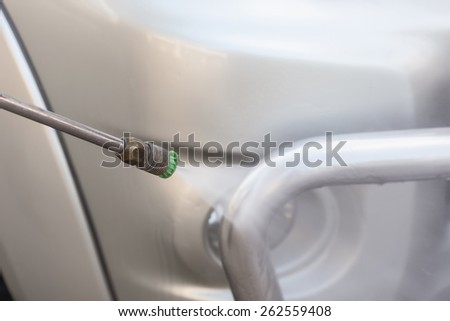 Close up Car washing with high pressure water jet - stock photo