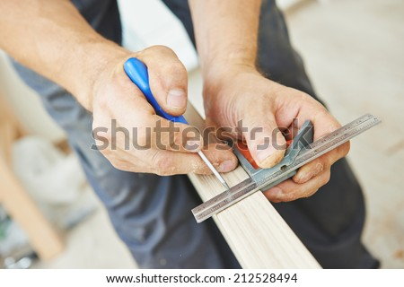 Close-up carpenter process of wood door marking for locksmith installation - stock photo