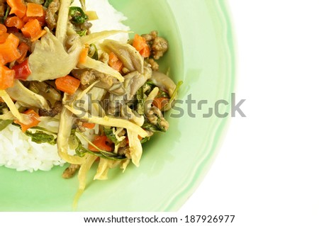 Close up carrot fried with oyster mushroom, vegan protein and basil on rice isolated white background.