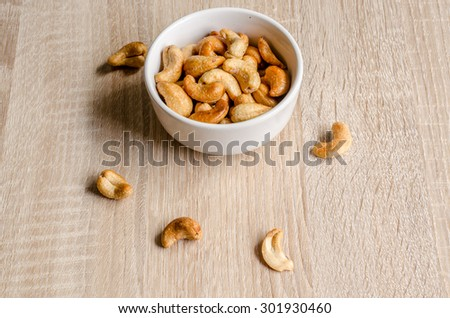 Close up cashew nuts on wooden background - stock photo