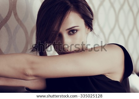 Close up casual style woman portrait in the interior - stock photo