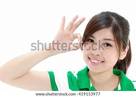 Close up casual young woman doing the ok sign on eye