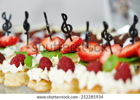 Close-up catering service sweets strawberries fruits at restaurant party - stock photo