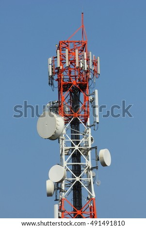 Close-up cell phone tower in blue sky