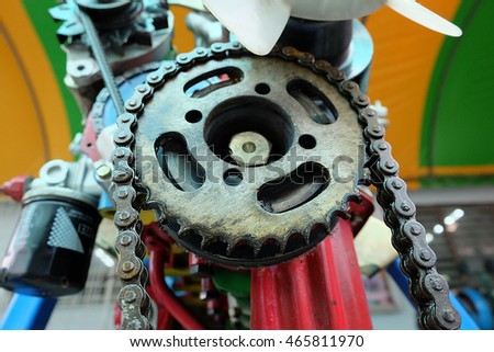 Close up chain and cogwheel in machine system