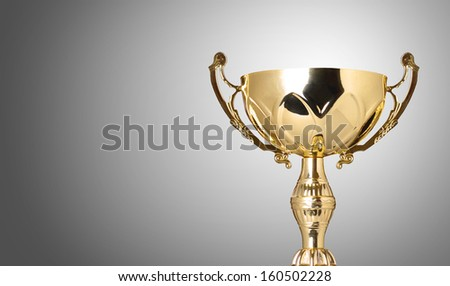 close up champion golden trophy on grey background