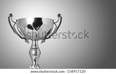 close up champion silver trophy on grey background - stock photo