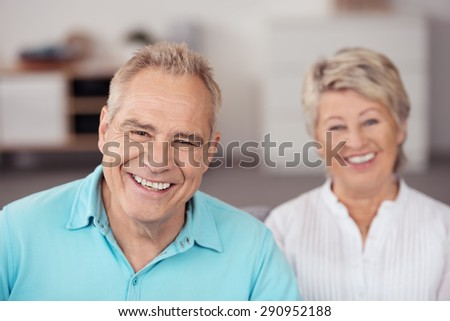 Close up Cheerful Middle Aged Husband Beside his Happy Wife, Smiling at the Camera. - stock photo
