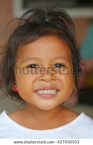Close up Child girl with a beautiful teeth