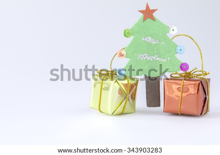 close up.  Christmas tree and gift box on white background