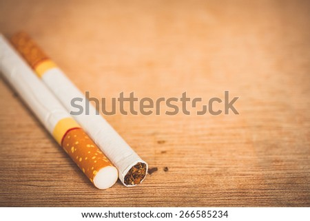 close-up cigarettes on wooden background - stock photo