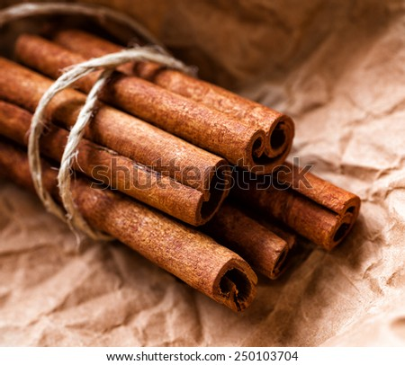 Close up, Cinnamon sticks bunch on craft paper - stock photo