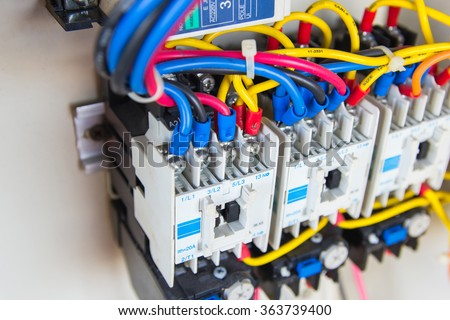 Close up circuit breakers and wire in control panel - stock photo