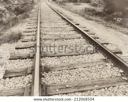 Close up closeup of a speedway railroad old rail railroad track vintage retro sepia - stock photo