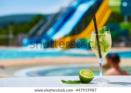 Close up Cocktail margaritas with lime near the swimming pool