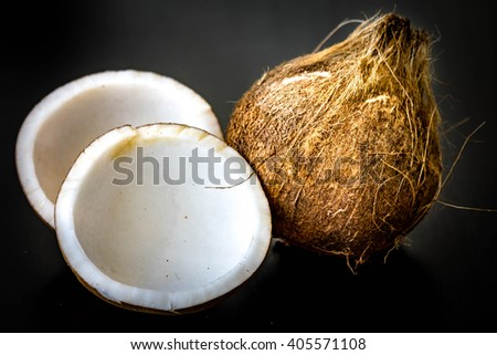 close up coconut on black background - stock photo