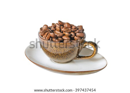 Close up coffee cup and beans on a white background. Beans coffee in cup. Coffee background. Coffee on table. Morning coffee. Marvelous coffee. Latte coffee. Coffee with out milk. - stock photo