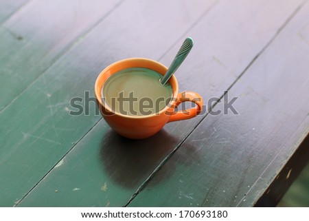 Close-up coffee cup on the wood table - stock photo