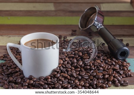 Close up coffee cup with beans - stock photo