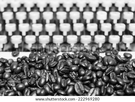 Close up coffee many mounds near the old typewriter keyboard is not in use. - stock photo