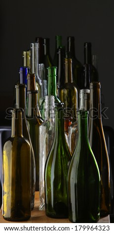 close-up collection of beautiful colored glass bottles on black background studio