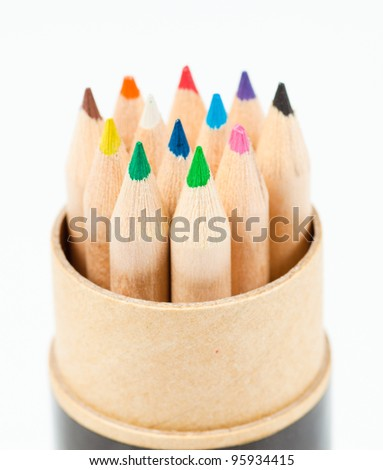 close up color pencils in cylinder box - stock photo