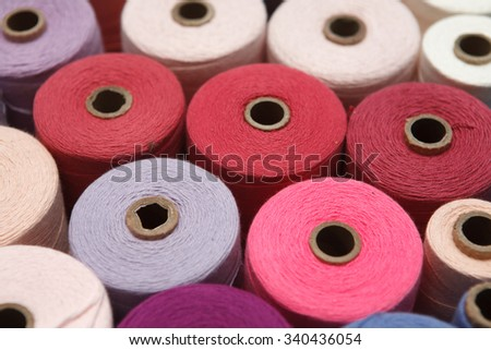 Close up color sewing threads as a background  - stock photo