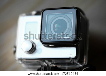 Close up color shot of a small action camera - stock photo