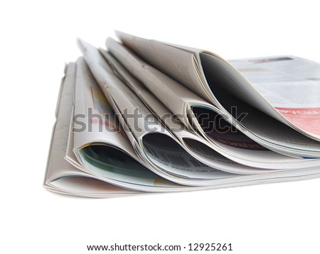 Close up colored newspapers lists isolated on white