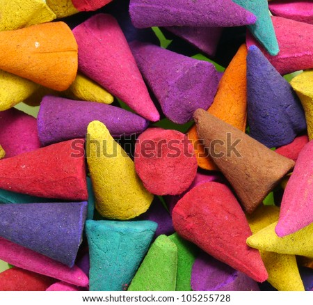 close up colorful incense isolated on white background