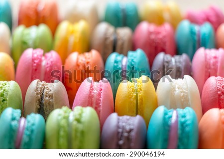 Close up colorful macarons dessert with vintage pastel tones made dept of field - stock photo