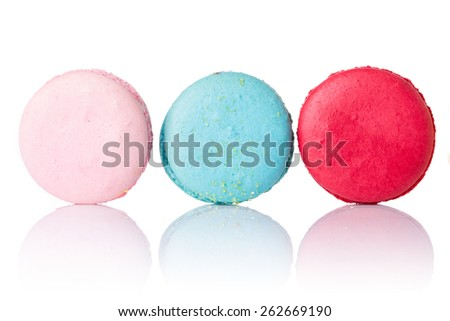 Close up colorful macaroons isolated on white background. - stock photo