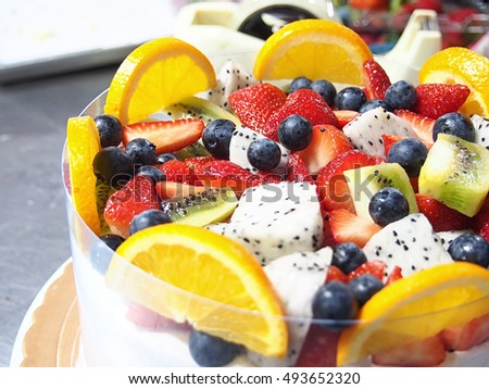 close up colorful mix fruit cake topping.
