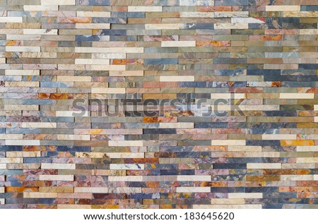 Close up colorful stone wall tiles decoration in living room - stock photo