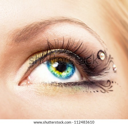 Close up Colourful human eye with makeup. Beauty and fashion