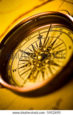 Close up compass on the old map - stock photo