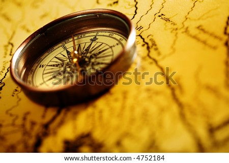 Close up compass on the old map background - stock photo