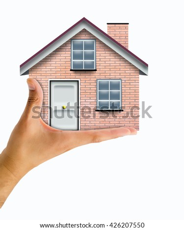 Close up conceptual shot of a man holding a house (home edited with photo of a wall) - stock photo