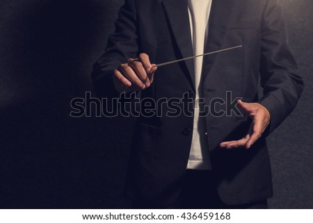 close up conductor in dark - stock photo