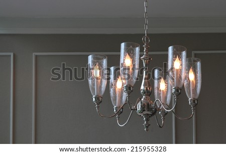 Close up contemporary chandelier in a room - stock photo
